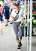 Elizabeth Banks keeps it casual in a white top and grey leggings while shopping at the Farmers Market in Los Angeles