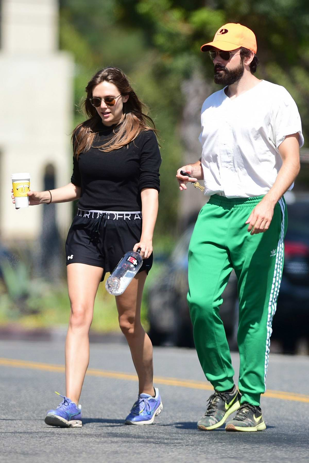 Elizabeth Olsen dons black top and shorts as she and Robbie Arnett head to the gym in Studio City, Los Angeles
