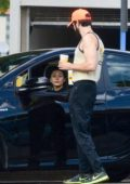 Elizabeth Olsen waits in the car while Robbie Arnett get some coffee in Studio City, Los Angeles