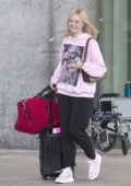 Elle Fanning flies into Toronto where boyfriend Max Minghella is filming the upcoming 'Saw' film, Canada