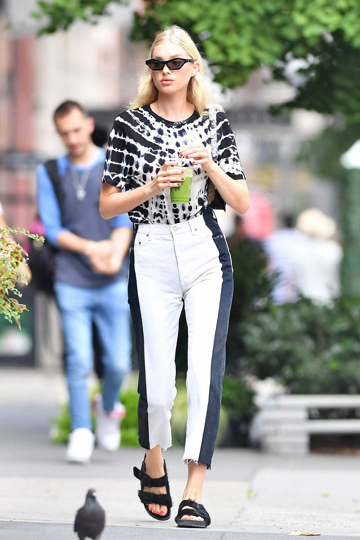 Elsa Hosk looks stylish in a tie-dye top as she steps out for a stroll in New York City