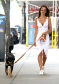 Emily Ratajkowski dons a white button-up dress as she takes her pup to the dog park in New York City