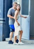 Emily Ratajkowski seen wearing a white dress as she stepped out with Sebastian Bear-McClaud in New York City