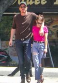 Emma Roberts and Garrett Hedlund engage in risque PDA during an outing in Los Feliz, California