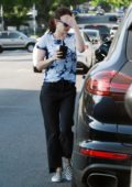 Emma Roberts keeps it casual in a tie-dye top and jeans while out for an iced coffee in Los Angeles