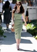 Emma Roberts looks cute in a green checkered dress while visiting Kate Sommerville Clinic in West Hollywood, Los Angeles