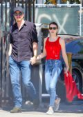 Emma Roberts seen wearing a bright red tank top and jeans while out for lunch with Garrett Hedlund in Hollywood, California