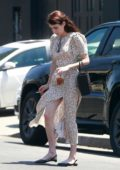 Emma Roberts wears a floral print slit dress for lunch with boyfriend Garrett Hedlund in Los Feliz, California