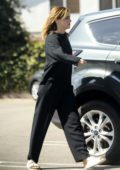 Emma Watson looks casual in all black while visiting Cedar Sinai Urgent Care in Culver City, California