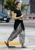Emma Watson wore black crop top and animal print pants while out for lunch with a friend at double-zero pizza in Venice, California