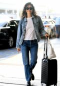 Emmy Rossum sports double denim as she arrives to catch an early flight at LAX in Los Angeles