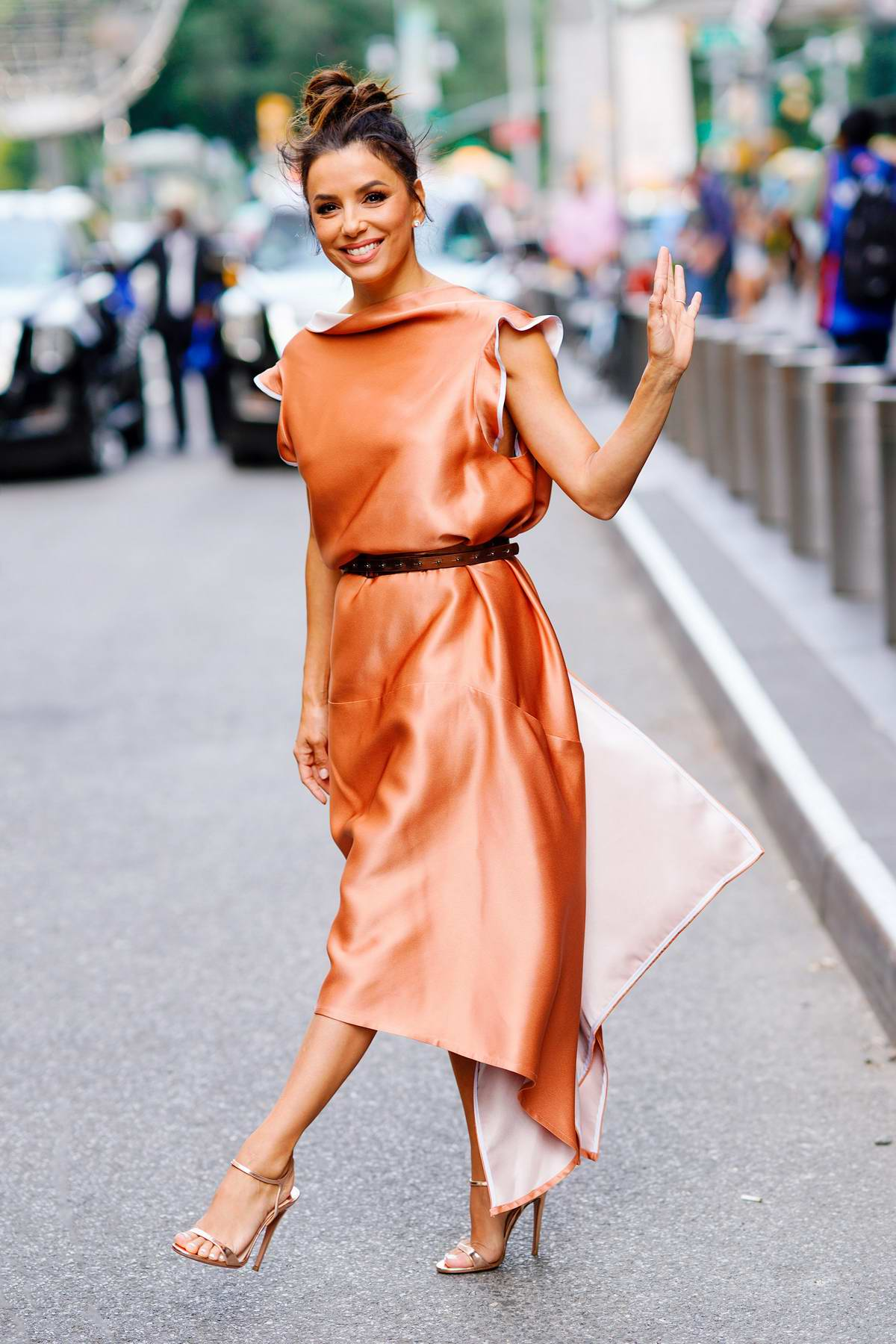 Eva Longoria wears a peach dress as she leaves Today Show in New York City