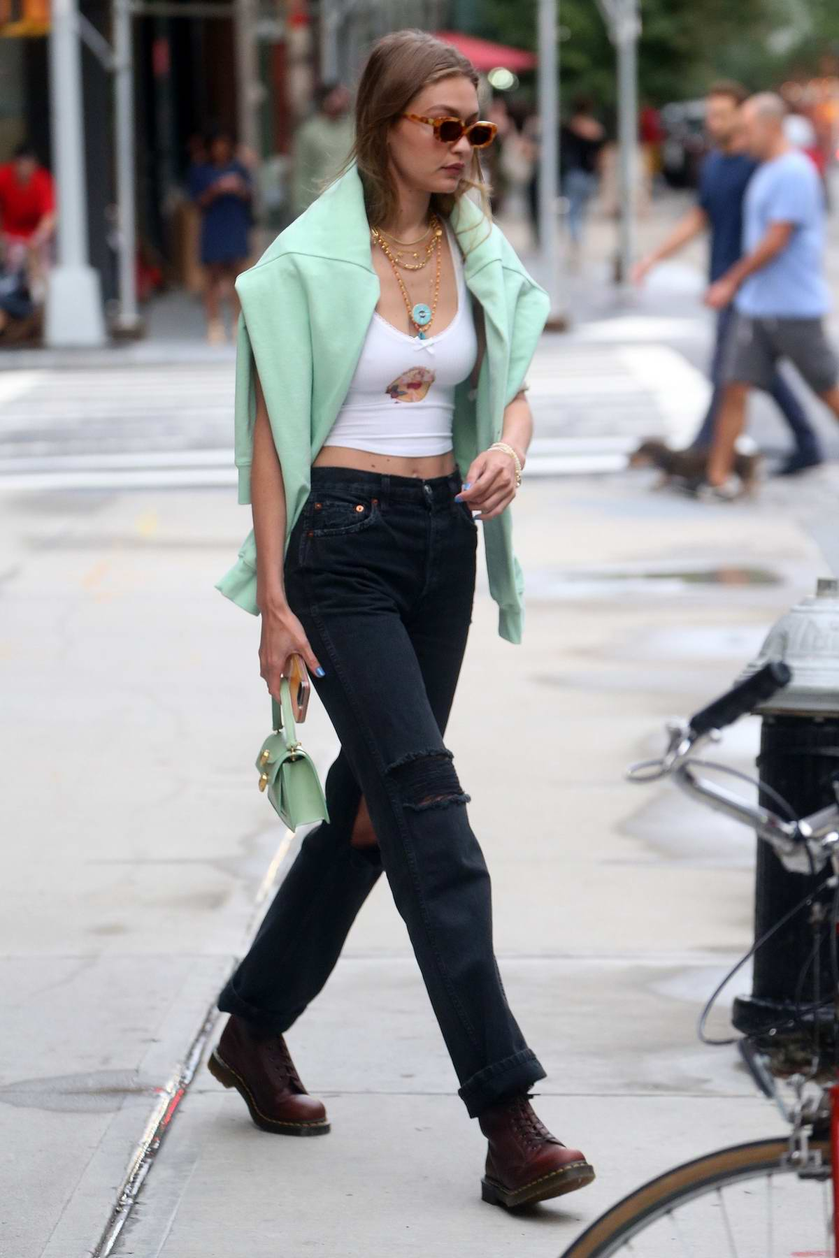 Gigi Hadid flashes her toned abs in a crop top as she steps out in New York City