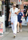 Gigi Hadid keeps it casual chic in all-white as she steps out for a stroll in New York City