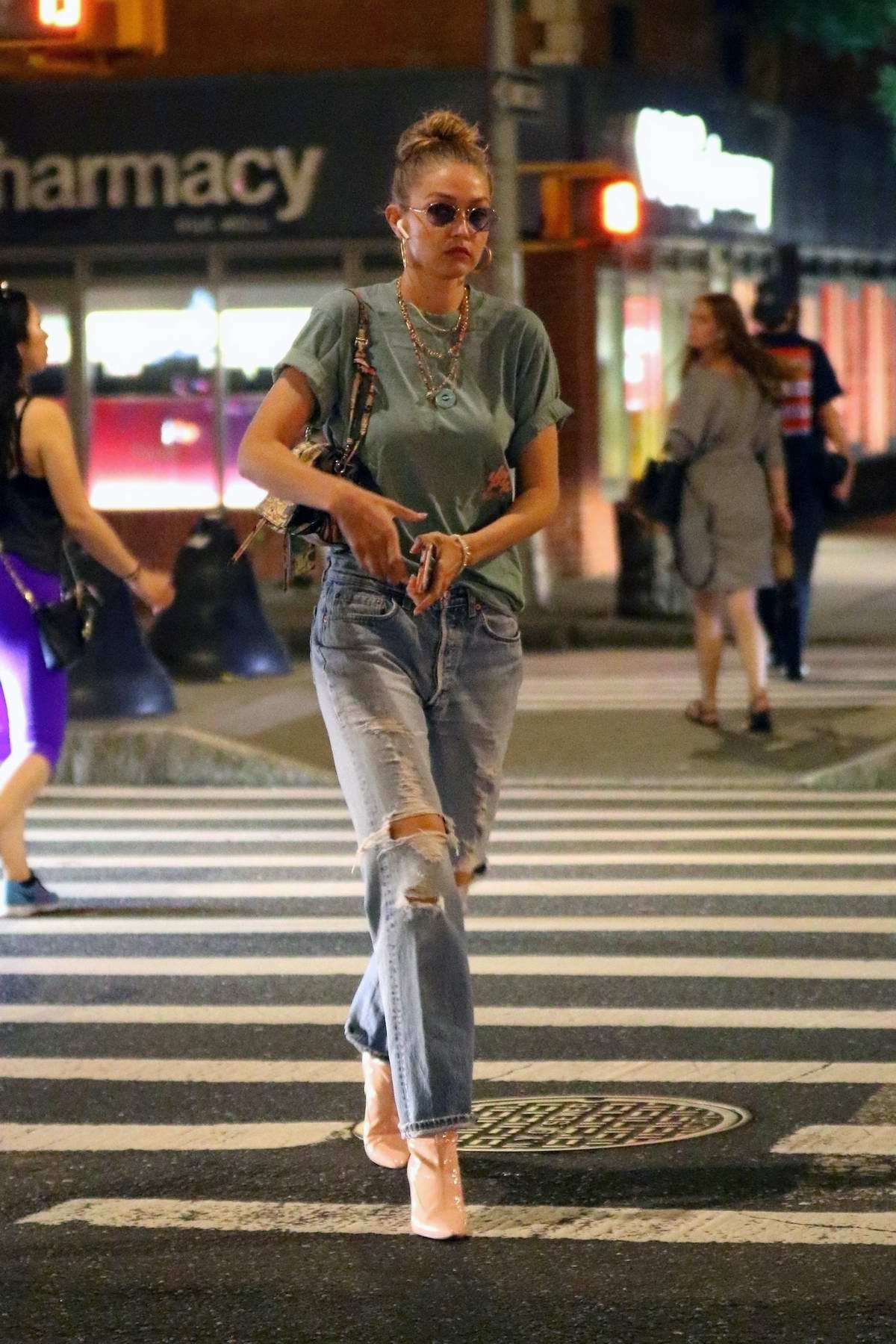 Gigi Hadid looks chic as she sports her sunglasses for a late night stroll through SoHo in New York City