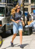 Gigi Hadid looks cool in a dark blue top and denim cutoffs while stopping by Blick Art store in New York City