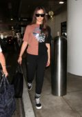 Hailee Steinfeld dons a two-toned top and black trousers as she touches down at LAX Airport in Los Angeles