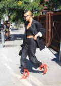 Hailey Baldwin looks stylish in all-black ensemble with red heels as she leaves lunch in West Hollywood, Los Angeles