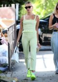 Hailey Baldwin looks stylish in mint green while making a coffee run with her stylist in West Hollywood, Los Angeles