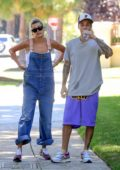 Hailey Baldwin spotted in denim overalls while out for a stroll with Justin Bieber in Beverly Hills, Los Angeles