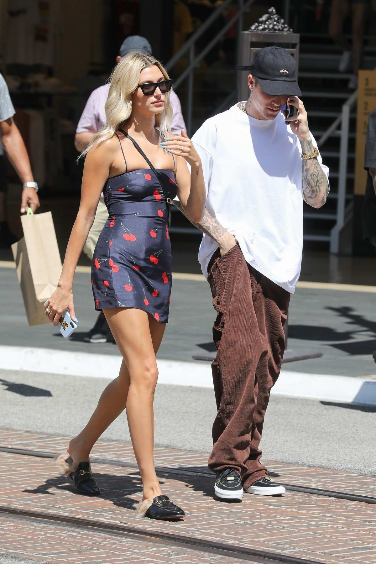 Hailey Baldwin wears a blue cherry print minidress while out with Justin Bieber at the Grove in Los Angeles
