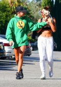 Hailey Baldwin wears a green oversized 'Drew' sweatshirt while heading to the gym with a friend in West Hollywood, Los Angeles