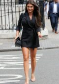 India Reynolds flaunts her legs in a black mini dress as she arrives at Cecconi's Restaurant in London, UK