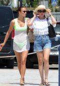 Irina Shayk seen wearing a neon green bikini while on vacation in Ibiza, Spain