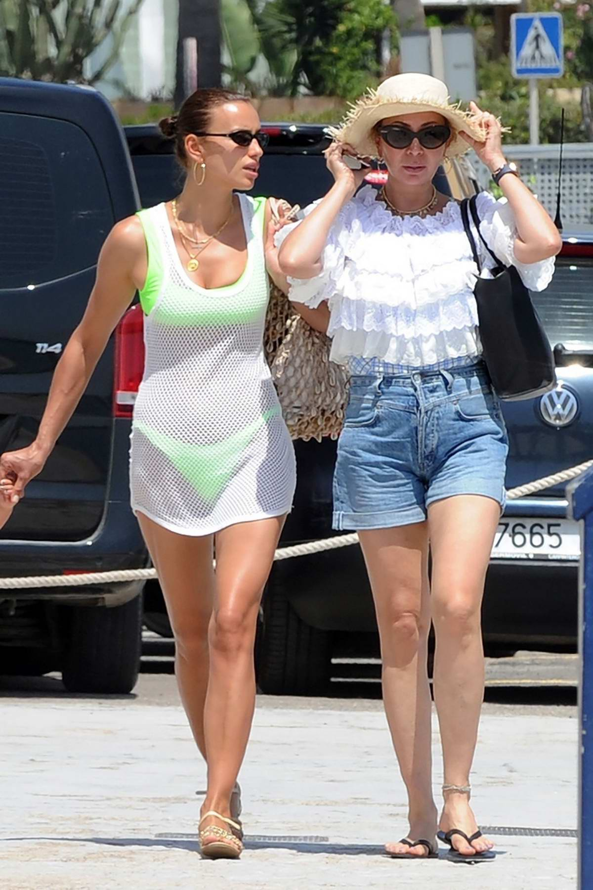 Irina Shayk seen wearing a neon green bikini while on vacation in Ibiza, Spain
