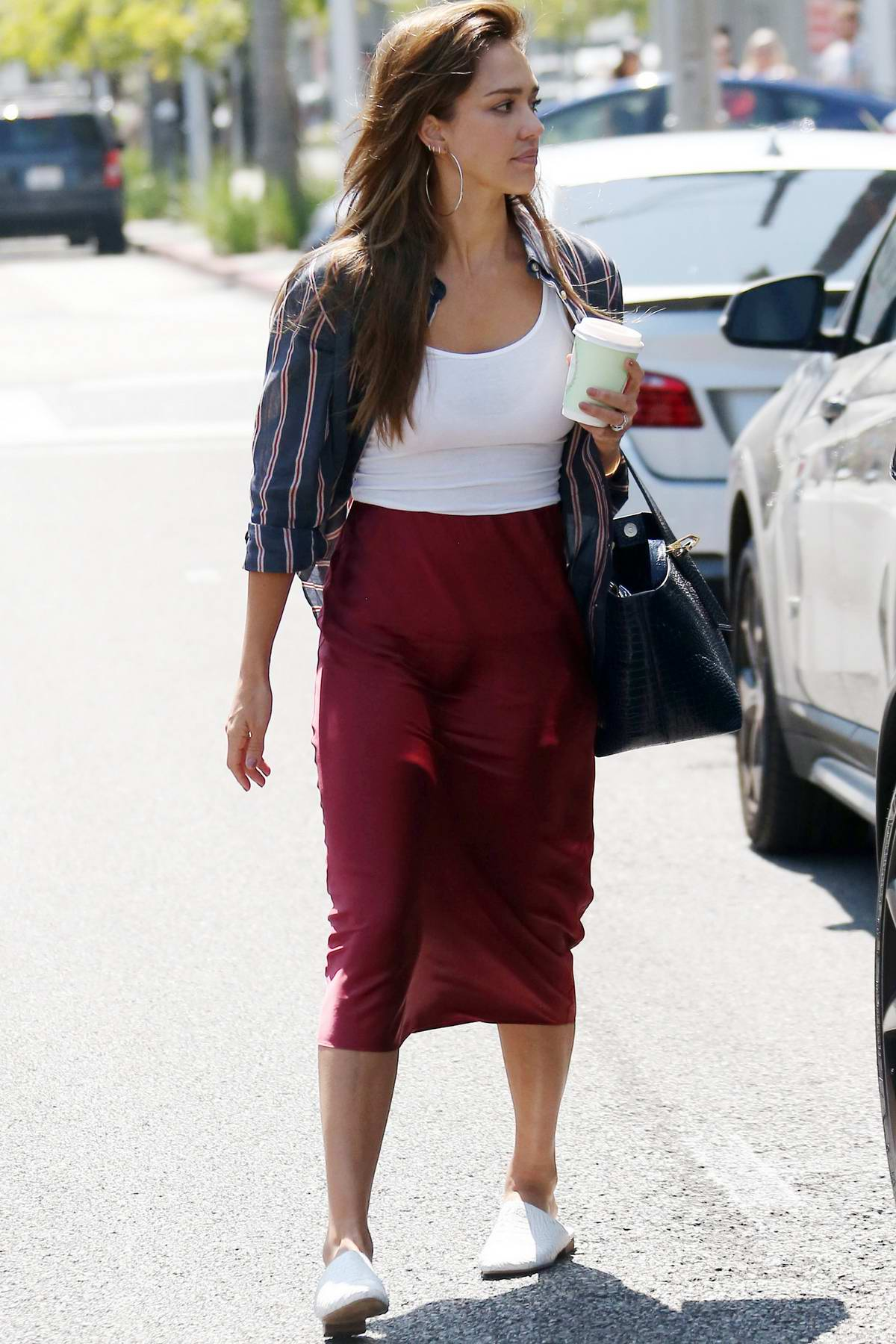 Jessica Alba looks lovely in a maroon silk skirt while out running errands in Beverly Hills, Los Angeles