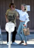 Julianne Hough hugs a friend as she leaves after lunch with Derek Hough in Sherman Oaks, California