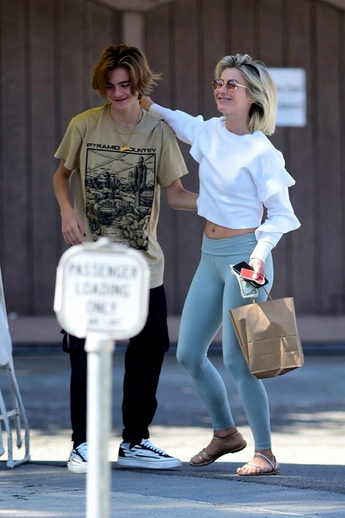 Julianne Hough hugs a friend as she leaves after lunch with Derek Hough in Sherman Oaks, California