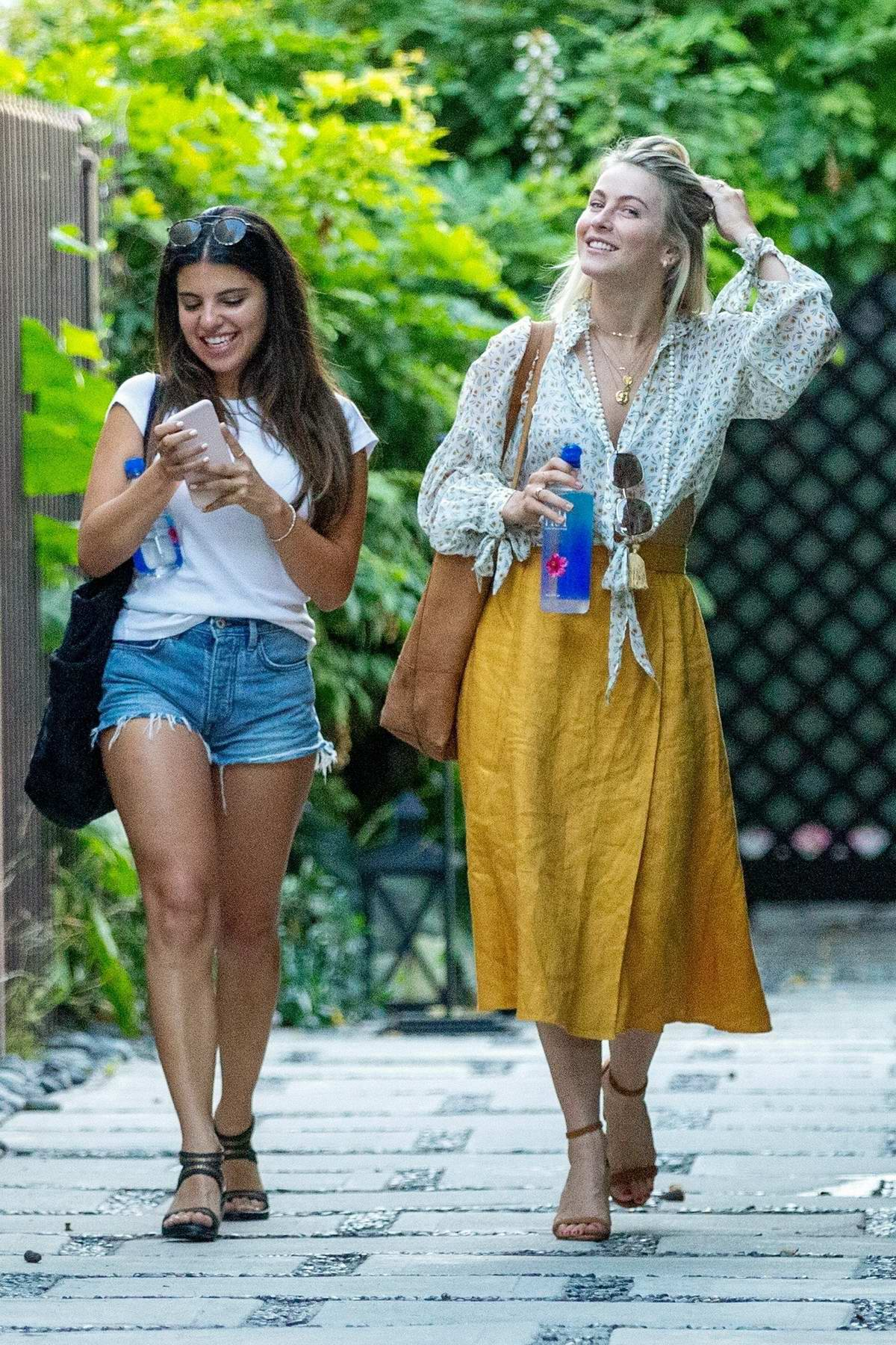 Julianne Hough stands out in a mustard yellow skirt as she leaves her office with her assistant in West Hollywood, Los Angeles