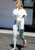 Julianne looks great in a white crop top and light blue leggings as she steps out after lunch in Los Angeles