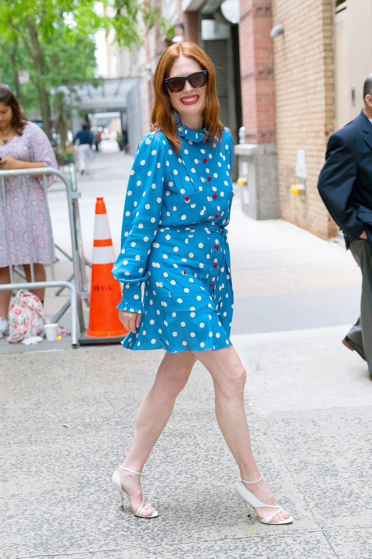 Julianne Moore stands out in a blue dress while visiting Kelly and Ryan Show in New York City