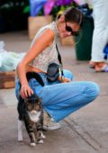 Kaia Gerber pets a cat while out for shopping with Cindy Crawford in Los Angeles