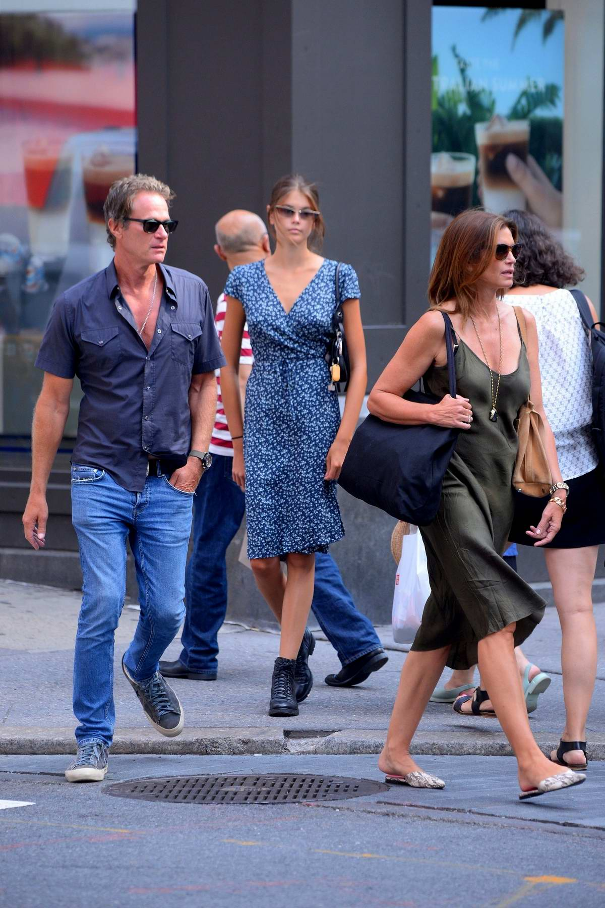 Kaia Gerber steps out for a stroll with her parents Cindy Crawford and Rande Gerber in New York City