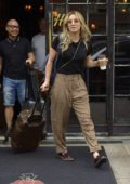 Kaley Cuoco looks stylish in a black top and brown gingham pants as she checks out of the Bowery Hotel, New York City