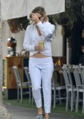 Kate Hudson sports a white hoodie and sweatpants while out for a healthy drink at Kreation in Brentwood, Los Angeles