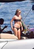 Kate Moss wears a black bikini as she takes a dive into the water in Portofino, Italy