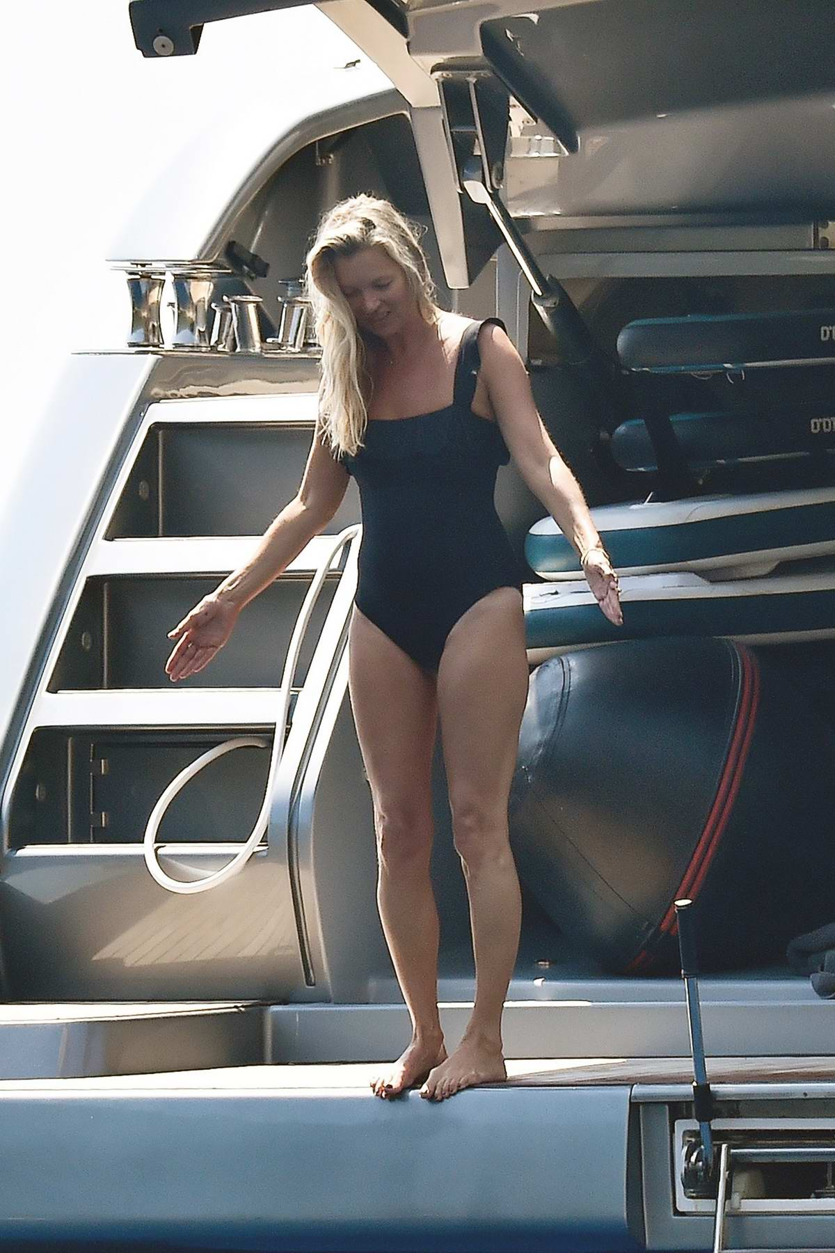 Kate Moss wears a black swimsuit enjoying her time on a yacht in Portofino, Italy