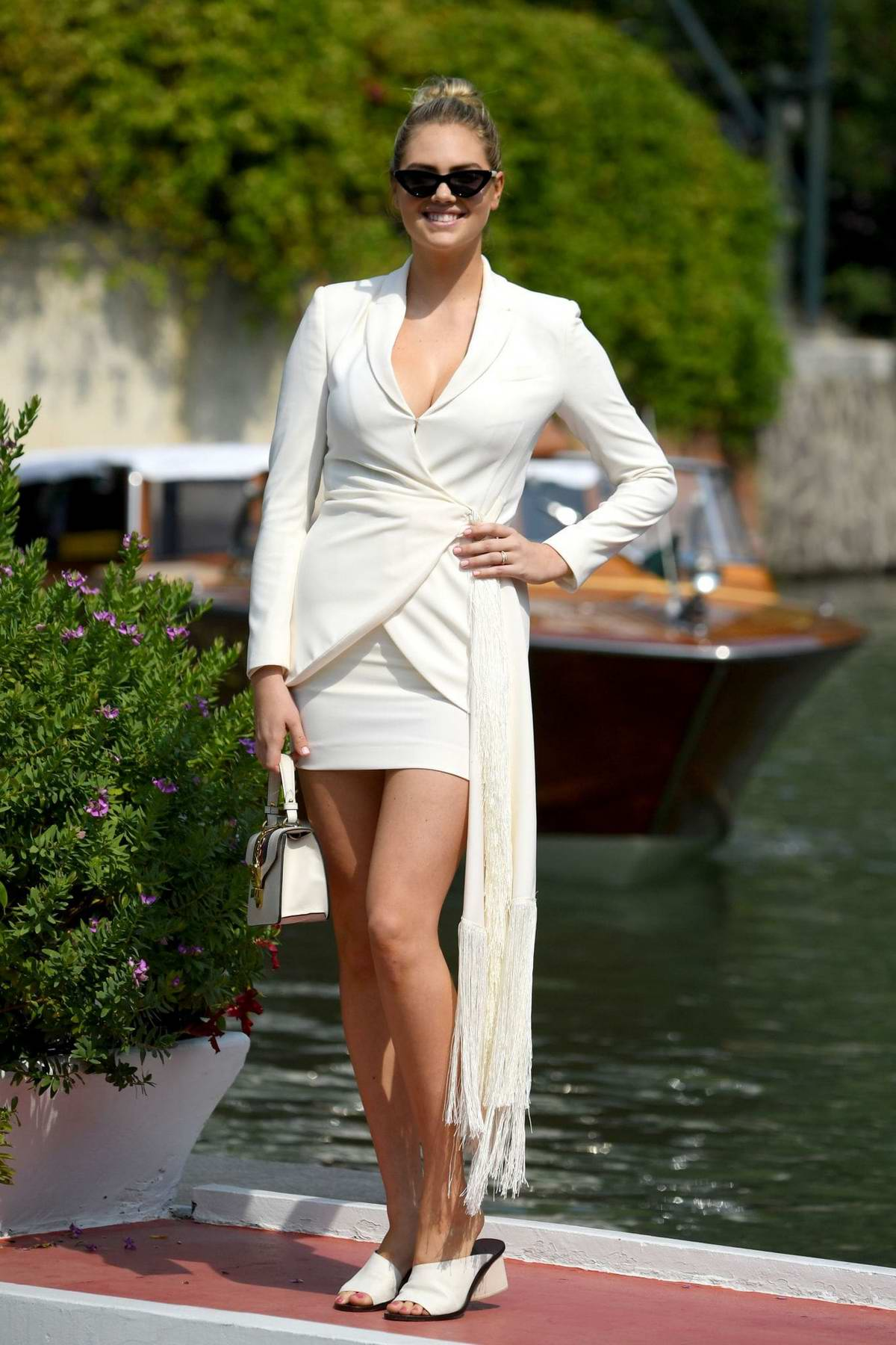 Kate Upton dazzles in white as she arrives at Excelsior Hotel during the 76th Venice Film Festival in Venice, Italy