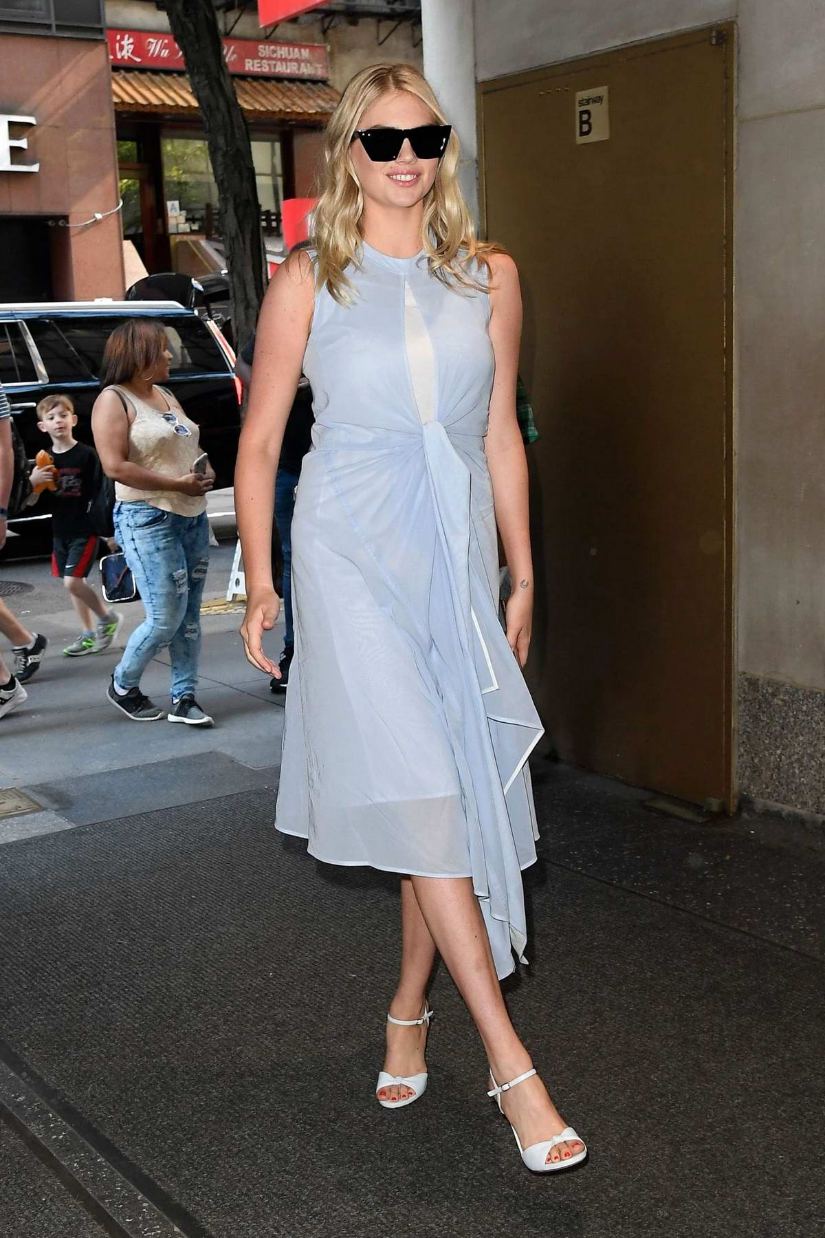 Kate Upton looks great in a light blue dress as she arrives at the 'Today' Show in New York City