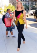 Kate Upton looks vibrant in yellow and black as she arrives at Bravo Studios in New York City