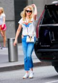 Kate Upton spotted in a 'Wonder Woman' top as she checks out of her hotel and heads to the airport in New York City