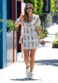 Katharine McPhee looks fab in a floral print dress during a trip to the hair salon in West Hollywood, California