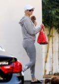 Katy Perry sports grey Adidas hoodie and leggings while leaving office with her pup Nugget in West Hollywood, Los Angeles