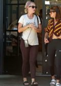 Katy Perry spotted in a cream top and brown leggings as she leaves a yoga class in Los Angeles
