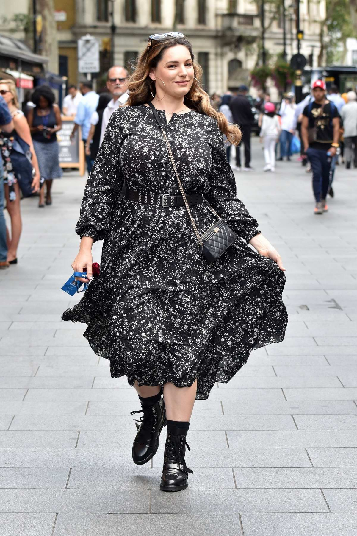 Kelly Brook dons a monochrome floral dress as she arrives for her show at Heart Radio in London, UK