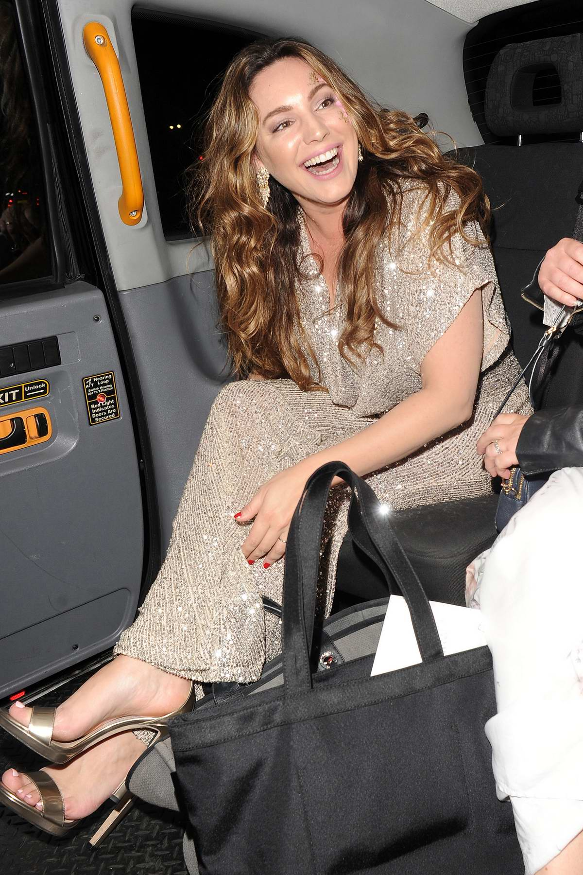 kelly brook is all smiles as she leaves heart fm summer